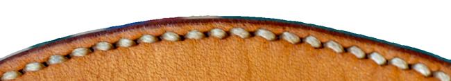 Couture main sur une selle âgée de 30 ans.